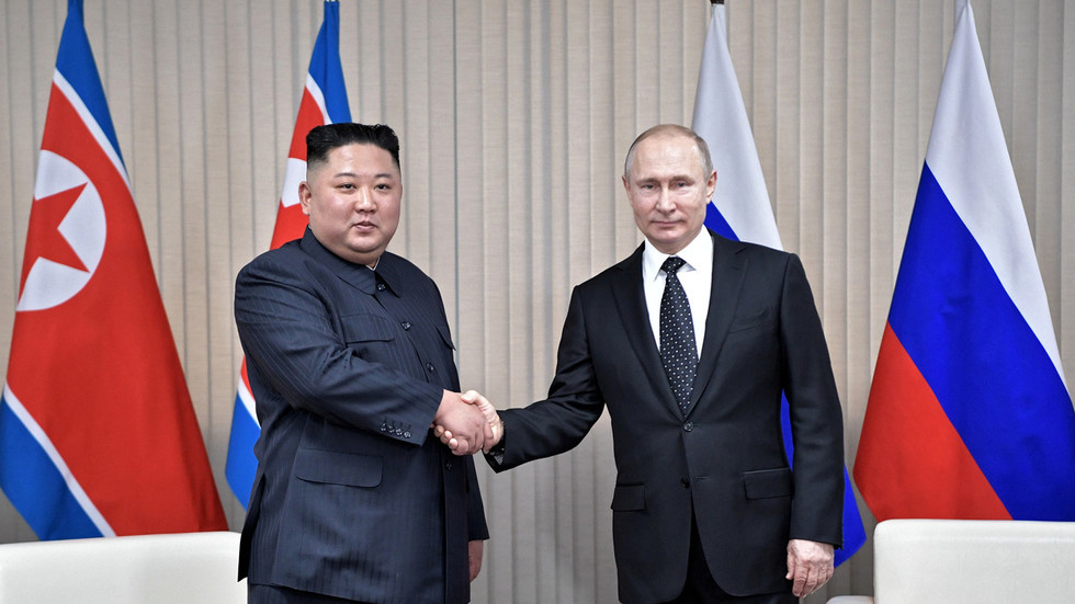 Putin and Kim's 'struggle for dominance' decided in first handshake – body language expert