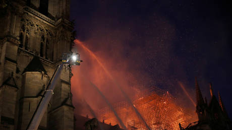 Notre Dame towers 'saved' from the blaze, French firefighters hope