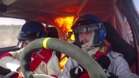 Rally drivers avoid tragedy, escape car as it bursts into flames mid-race (VIDEO)