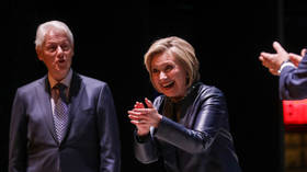 Hillary Clinton shows signature style as she chuckles over Assange's arrest