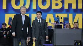 Seriously now: Weary Ukrainian voters face ultimate choice between comedian & politician