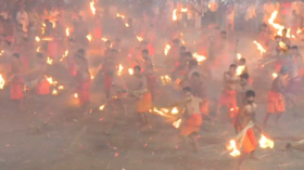 Fight fire with fire: Hundreds of Indian men try to set each other ablaze to appease goddess (VIDEO)