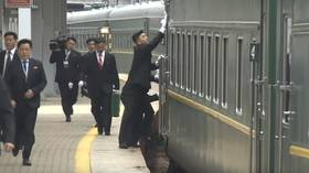 WATCH Kim Jong-un's bodyguards POLISH his moving train as it arrives in Russia's Far East