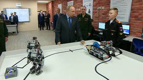 Ready, steady, go! Sporty robots perform push-ups for Putin (VIDEO)