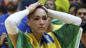 Brazilian volleyball star faints midway through live court-side interview (VIDEO)