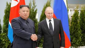 First handshake: Putin greets Kim on historic visit to Russia (VIDEO)
