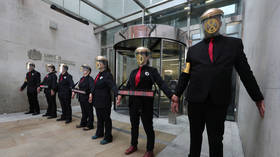 Sticking it to the man: Climate change protesters glue themselves to London Stock Exchange (VIDEO)