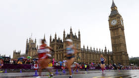 Clocked off! - London Marathon runner's Big Ben outfit can't fit through finish line (VIDEO)