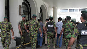 Sri Lankan authorities warn of 'another wave of attacks' by 'persons dressed in military uniforms'