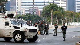 Caracas warns it'll use weapons if needed as crowds of coup supporters flock to presidential palace
