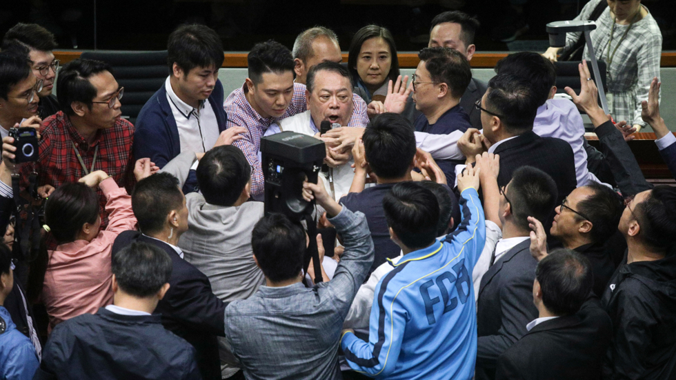 Fists fly in Hong Kong parliament as debate over extradition law boils over