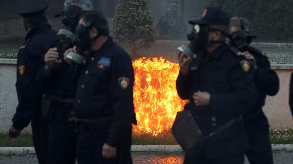 Protestors toss firebombs at govt office in Albania as opposition demands PM's resignation