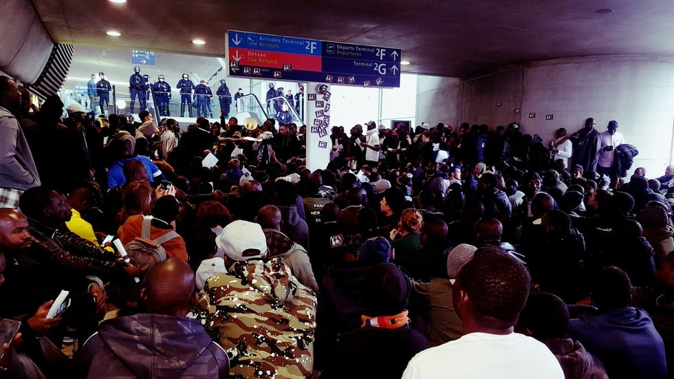 'France does not belong to the French!' 100s of 'Black Vest' migrants occupy Paris airport