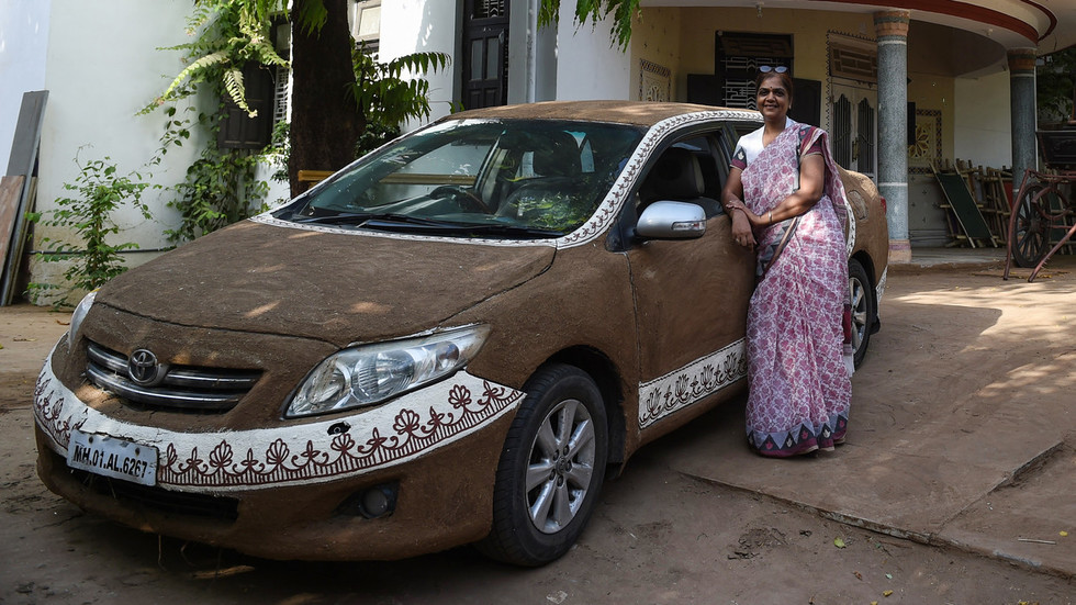 'Toyota Cow-rolla': Indian woman plasters her car with bovine DUNG to cool it down (PHOTOS)