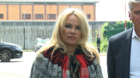 'We need to save his life': Pamela Anderson speaks of emotional visit to Assange prison