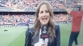 On your head! Touchline reporter gets flattened by stray ball during Valencia vs Arsenal warm-up
