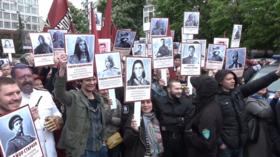 Ukrainian nationalists mock Immortal Regiment march with portraits of Avengers (VIDEO)