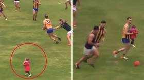 Stray toddler rescued by Aussie footballer after running onto pitch during game (VIDEO)