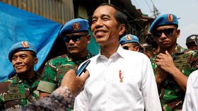 Indonesian President Widodo wins re-election, official count shows, as opponent refuses to concede