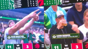 NFL superstar Aaron Rodgers loses out in beer-drinking competition during NBA playoffs (VIDEO)