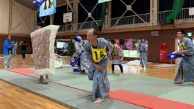 Togs away: Feathers fly in All-Japan Pillow Fighting Championships