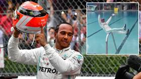 Making a splash: Lewis Hamilton celebrates Monaco GP win by jumping into swimming pool (VIDEO)