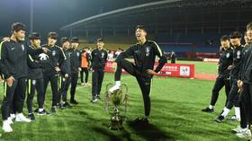 'Barbaric': South Korean footballers stripped of China trophy over 'foot on cup' celebration