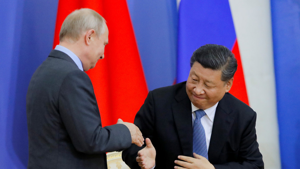 Russia stays clear of US-China trade war… but roots for 'strategic partner' – Putin