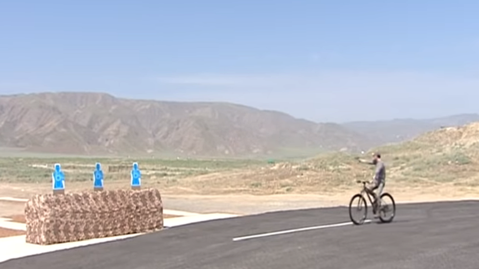 Turkmenistan's president practices drive-by shooting tactics on his bike, because.. why not?