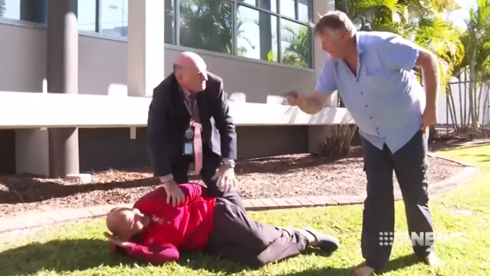 Cop tackles man to the ground during Queensland press conference