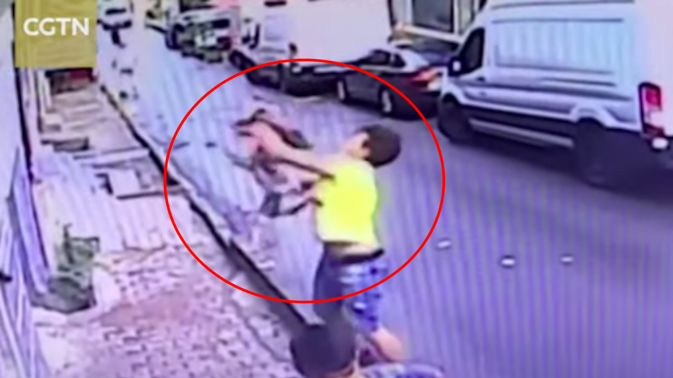 Teenager saves toddler from 2-story fall in spine-chilling VIDEO