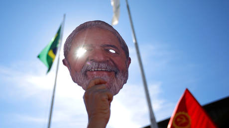 A supporter holds a mask depicting Luiz Inacio Lula da Silva during a protest against the Brazil's Justice Minister in Brasilia on June 10, 2019.