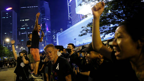 Protesters chant slogans during a demonstration in Hong Kong В© REUTERS / Thomas Peter
