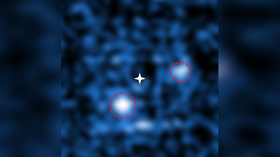 It's a planet! Two newborn exoplanets caught sucking in matter from distant star