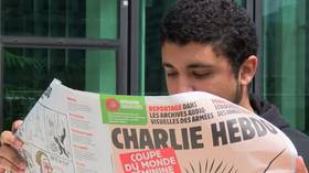 Charlie Hebdo kicks up controversy with vagina Women's World Cup cover (VIDEO)