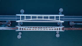 Connecting Russia: First railroad span across Crimean Bridge complete