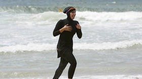 French town shuts two public pools over burkini ban protest