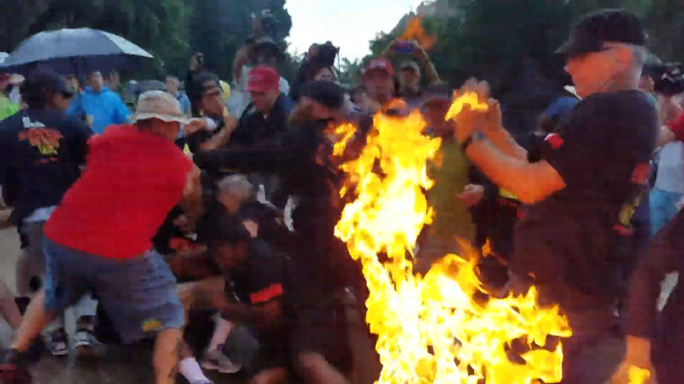 July 4 Protesters Toss Burning US Flag At Secret Service