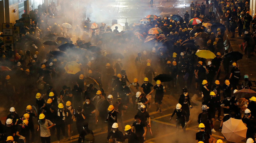 Hong Kong police use tear gas, rubber bullets as protesters target Chinese govt office
