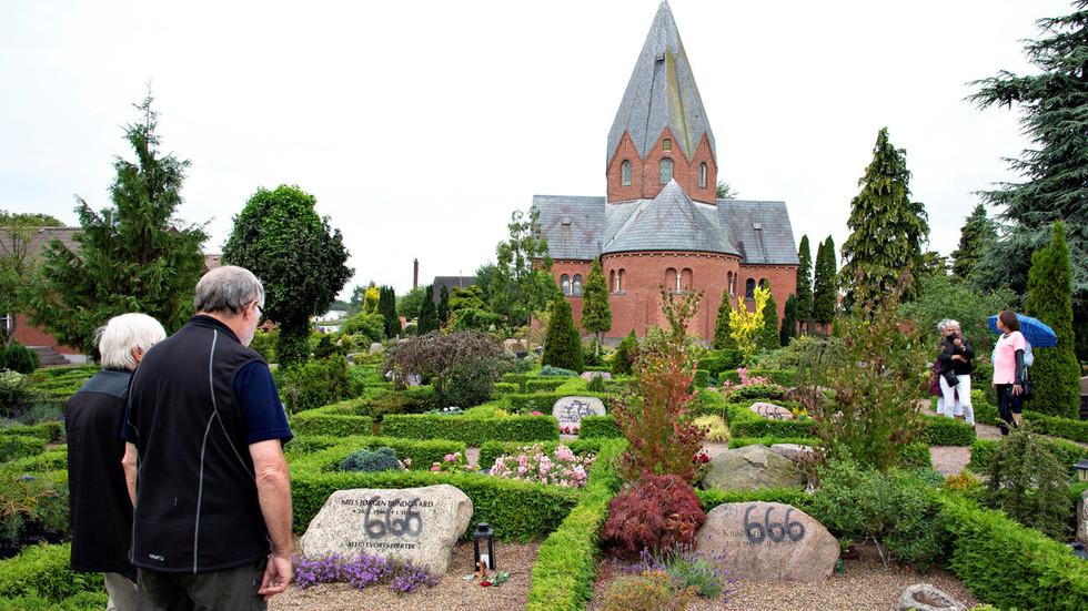 Satanic '666' graffiti sprayed on dozens of graves in Danish cemetery (PHOTOS)