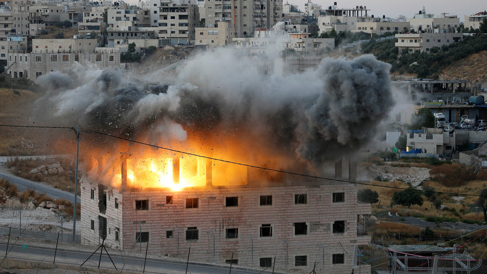 Israeli forces laugh and cheer as they blow up West Bank building