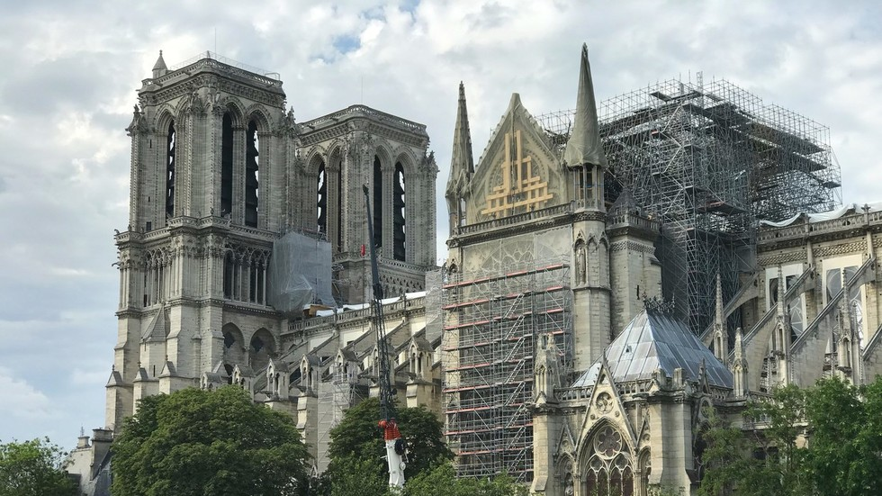 Schools near burnt-out Notre Dame closed over LEAD POISONING fears