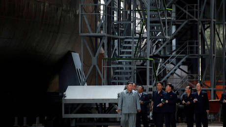 Kim Jong-un tours 'powerful submarine' to be deployed east of N. Korea's coast