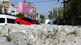 'I've never seen it before': Mexican city buried under 2m of ice in freak hailstorm (PHOTOS, VIDEOS)