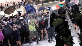 Umbrellas v. batons: Protesters clash with police at Hong Kong mall (VIDEO)
