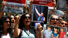 3 Turkish rights activists acquitted of terror-related charges