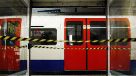 Manhunt after 2 men release tear gas on packed train in central London