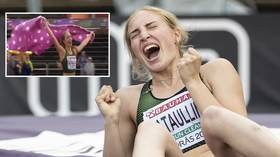 Covering herself in glory! Russian pole vaulter celebrates with blanket instead of flag (VIDEO)