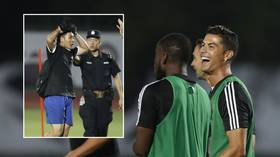 WATCH: Cristiano Ronaldo jumps on Chinese police officer as fan invades Juve training