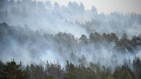 Siberia & Urals suffocated in smoke amid massive wildfires (VIDEOS)
